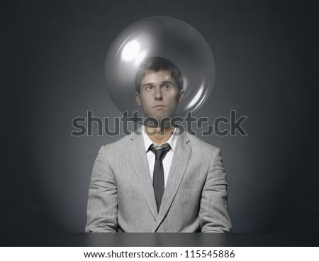 young businessman with head in a transparent bubble - stock photo
