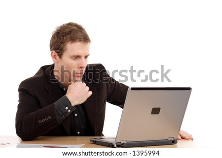 Young businessman with laptop - stock photo
