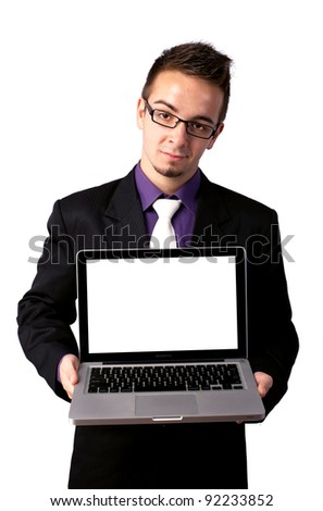 Young businessman with laptop, isolated on white - stock photo