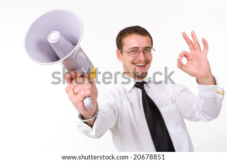 Young businessman with megaphone showing OK - stock photo