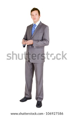 Young businessman with mobile phone   isolated on white background - stock photo