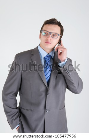 Young businessman with mobile phone wearing glasses - stock photo
