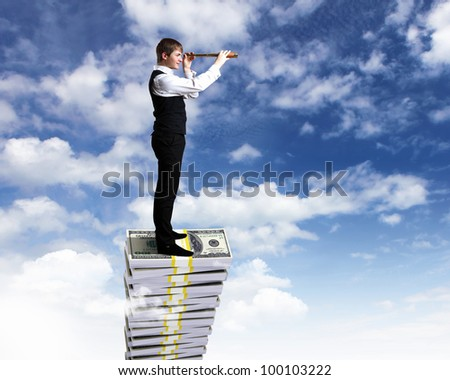 Young businessman with money symbols against blue skyy background - stock photo