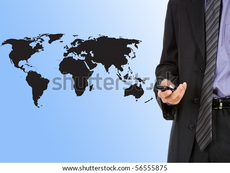young businessman with phone on world map backgorund - stock photo