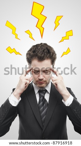 Young  businessman with storm inside the head. Lightning going through the head and brain. Concept of headache or the power of mind. Conceptual image of a open minded man. On a gray background - stock photo