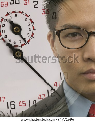 Young businessman with superimposed stopwatch image - stock photo