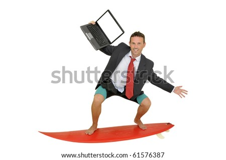 Young businessman with surf board and laptop - stock photo