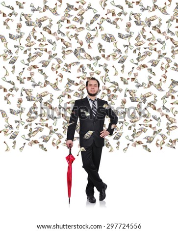 young businessman with umbrella and flying dollar bills - stock photo