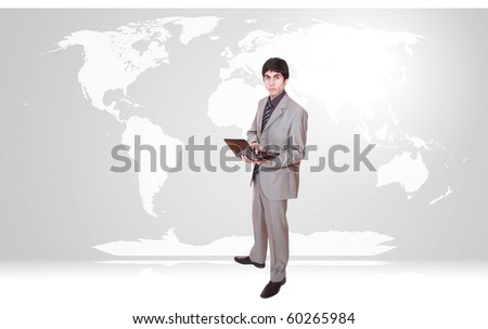 Young businessman with world map background - stock photo