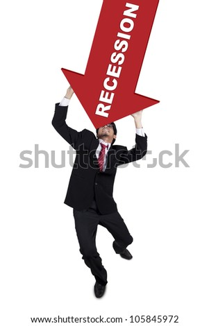 Young businessman withstand an arrow recession sign by use his hand, isolated on white - stock photo