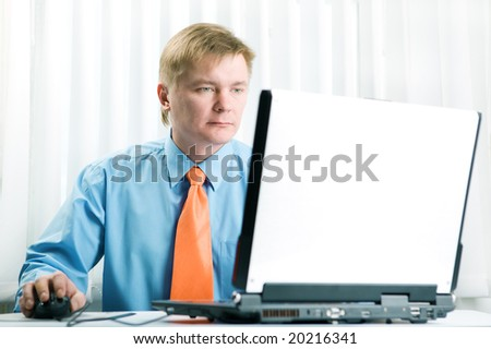 Young  businessman work on laptop - stock photo
