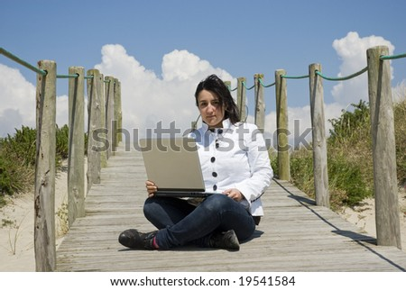 young businessman working at beach