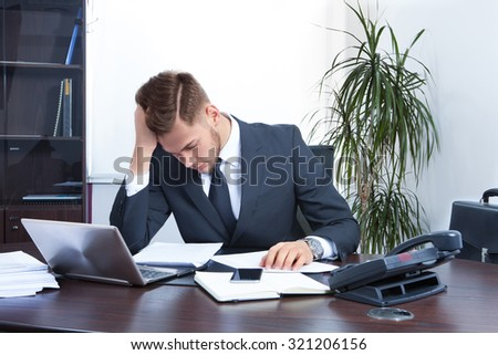 young businessman working in the Office with laptop