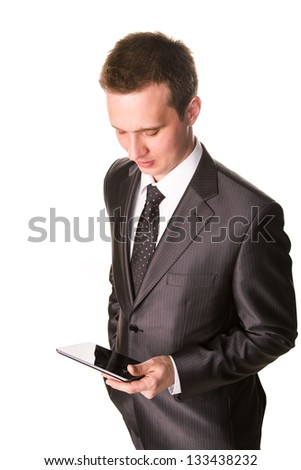 Young businessman working on a tablet pc comuter isolated on white