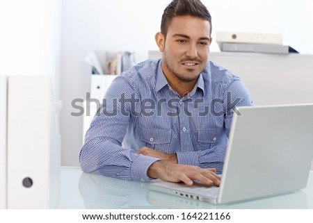 Young businessman working on laptop computer. - stock photo