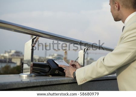 Young businessman working outdoor - stock photo
