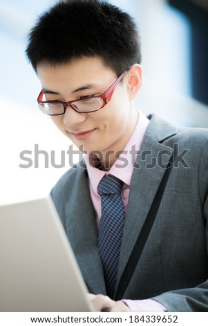 young businessman working outside with laptop