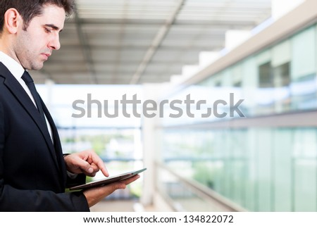 Young businessman working with digital tablet - stock photo