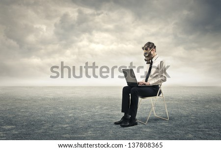 young businessman working with gas mask