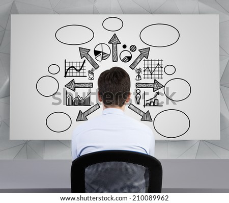 Young businessman works at start up strategy of a new business project. Sitting businessman in front of white board, - stock photo