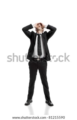 Young businessman worried with a bad business, isolated over a white background - stock photo