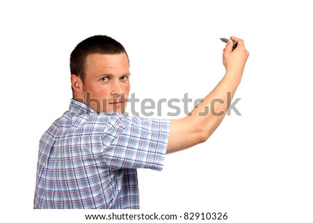 Young businessman writing something with a marker, isolated over white background - stock photo