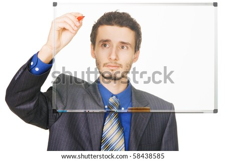 Young businessman writing something with a marker on blackboard, white background