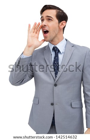 Young businessman yelling on white background