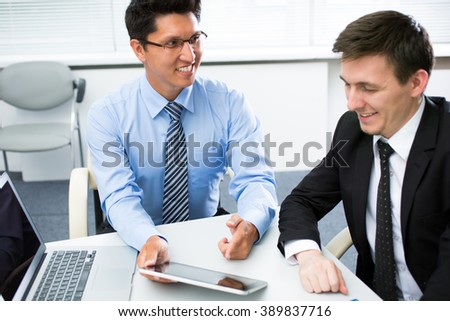 Young businessmen working in office with laptop.