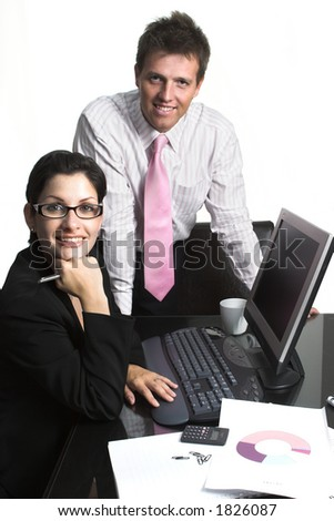 Young businesspeople are working on computer. Image is isolated on white.