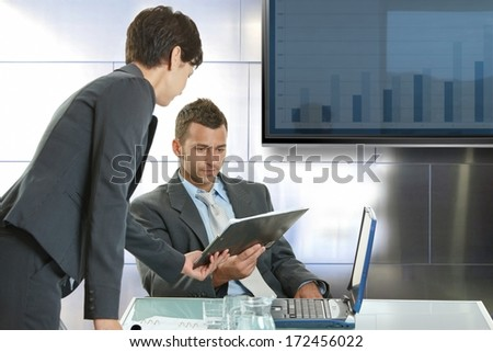 Young businesspeople consulting at meetingroom. - stock photo