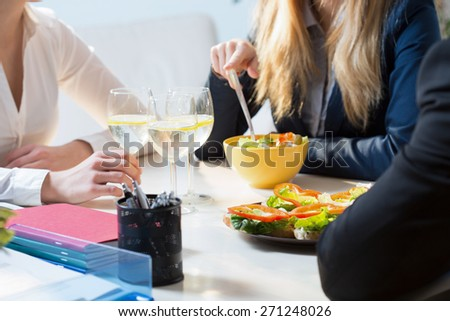 Young businesspeople during their break in office - stock photo