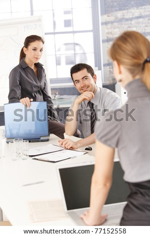 Young businesspeople having training, smiling.? - stock photo