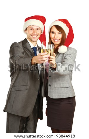 Young businesspeople in santa hat drinking champagne isolated on white background - stock photo