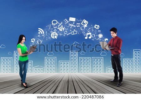 Young businesspeople using laptop computer for sending information - stock photo