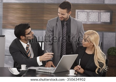 Young businesspeople working together in meetingroom. - stock photo
