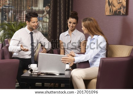 Young businessteam working with laptop in coffee bar. - stock photo