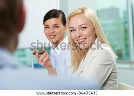 Young businesswoman addressing her colleague - stock photo