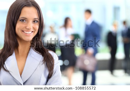 Young businesswoman and her colleagues - stock photo