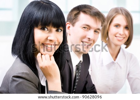 Young businesswoman and her team, - stock photo