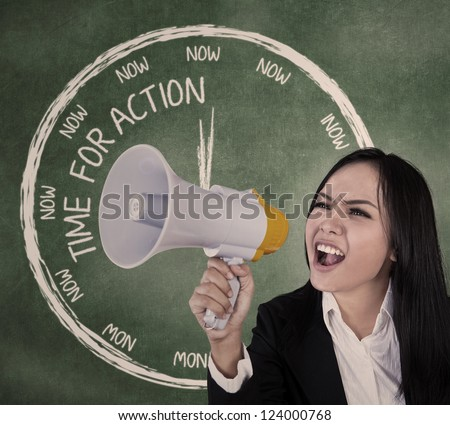 Young businesswoman announcing using speaker in classroom