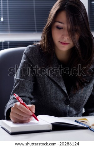 young businesswoman at the office - stock photo
