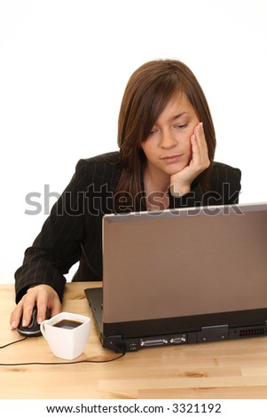 young businesswoman at work - laptop on desk - stock photo
