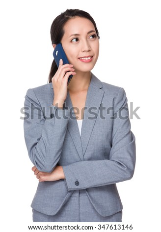 Young Businesswoman chat on mobile phone - stock photo