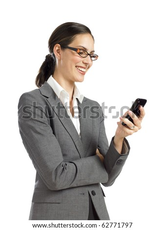 Young businesswoman checking cell phone - stock photo