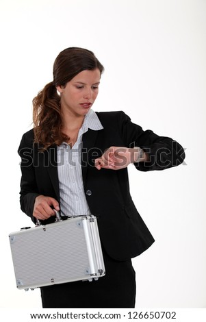 young businesswoman checking her watch - stock photo