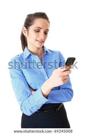 young businesswoman checks her mobile phone, isolated on white background - stock photo