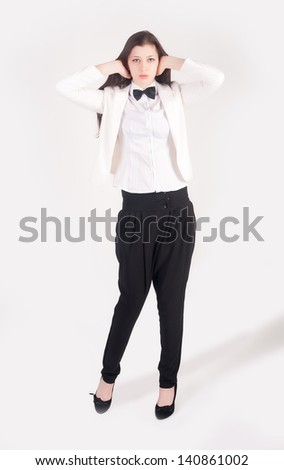 Young businesswoman covering her ears with hands on white background. No evil hear gesture - stock photo
