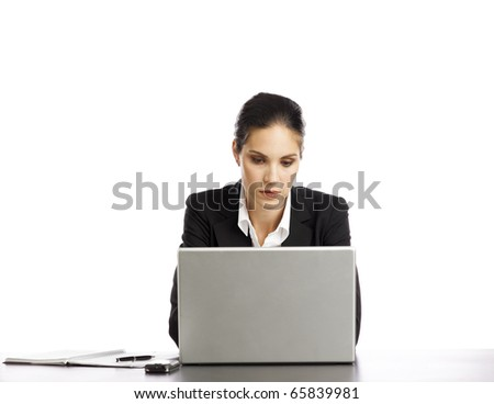 Young Businesswoman depressed looking at laptop - stock photo