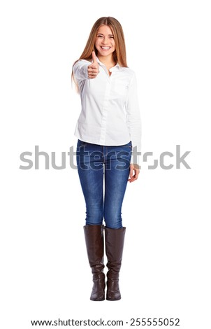 Young businesswoman doing ok gesture with thumb up  - stock photo